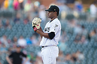 Charlotte Knights starting pitcher Reynaldo Lopez (40) looks to his catcher for the sign against the Durham Bulls at BB&T BallPark on May 16, 2017 in Charlotte, North Carolina.  The Knights defeated the Bulls 5-3. (Brian Westerholt/Four Seam Images)