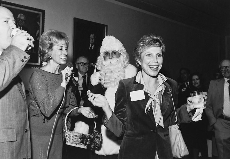 Staff member announcing prize winner at Christmas party in 1982. (Photo by CQ Roll Call via Getty Images)