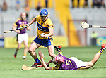 Podge Collins of Clare in action against Paudie Foley of Wexford during their All-Ireland quarter final at Pairc Ui Chaoimh. Photograph by John Kelly.