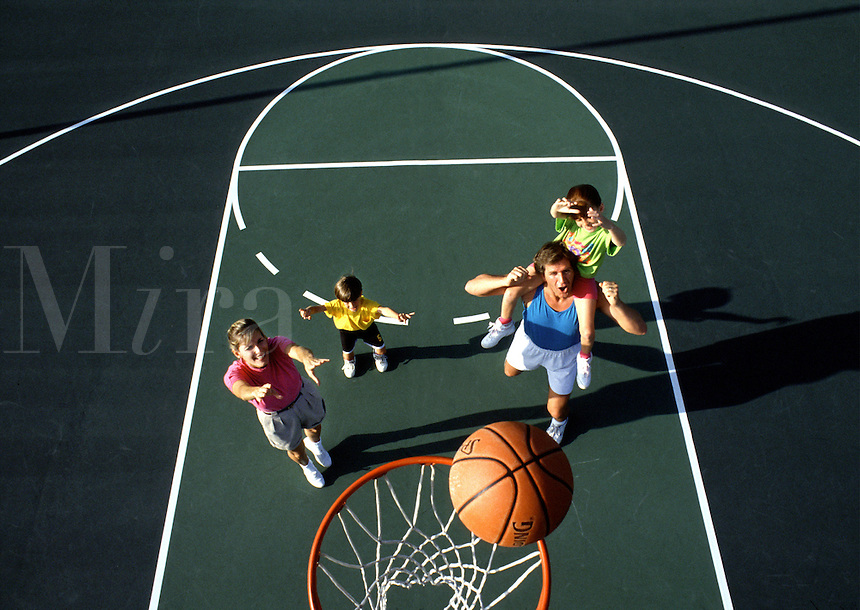 A family playing basketball together.