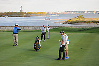 Adam Scott (AUS) checks on the wind before his approach shot on 14 during round 2 Four-Ball of the 2017 President's Cup, Liberty National Golf Club, Jersey City, New Jersey, USA. 9/29/2017.<br /> Picture: Golffile | Ken Murray<br /> <br /> All photo usage must carry mandatory copyright credit (&copy; Golffile | Ken Murray)