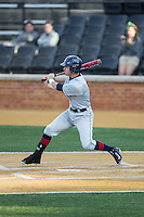 Bryan Daniello (1) of the UConn Huskies follows through on his swing against the Wake Forest Demon Deacons at Wake Forest Baseball Park on March 17, 2015 in Winston-Salem, North Carolina.  The Demon Deacons defeated the Huskies 6-2.  (Brian Westerholt/Four Seam Images)