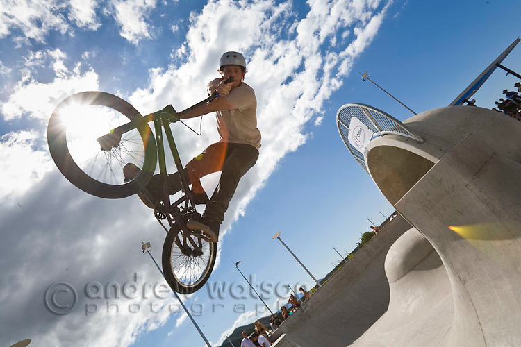 BMX rider performing trick at skate park.  Cairns, Queensland, Australia