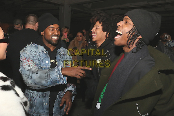 NEW YORK, NY - FEBRUARY 10: Kanyes West and Asap Rocky at the Yeezy Season 2 Zine Launch Party during New York Fashion Week 2016 in New York City on February 10, 2016. Credit: Jamel Johnson/MediaPunch<br /> CAP/MPI/JJ<br /> &copy;JJ/MPI/Capital Pictures