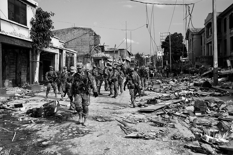 Port Au Prince, Haiti, Jan 23 2010.A platoon from the 82nd Airbone patrols the streets of downtown Port au Prince, to secure the area around an ongoing rescue operation..