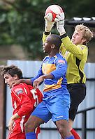 Aveley goalkeeper Lloyd Anderson claims a cross above Dave Dalleba of Romford - Romford vs Aveley - Pre-Season Friendly Match at Mill Field, Aveley FC - 31/07/10 - MANDATORY CREDIT: Gavin Ellis/TGSPHOTO - Self billing applies where appropriate - Tel: 0845 094 6026
