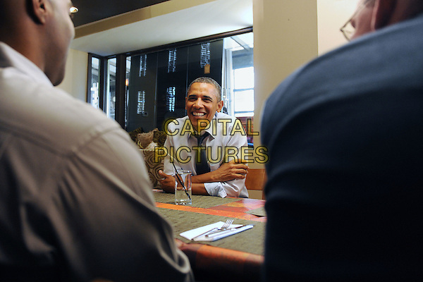 United States President Barack Obama (front L) has lunch with winners of a campaign contest, at Scion Restaurant in Washington DC, USA, .6th January 2012. .CAP/ADM/CNP/MR.©Michael Reynolds/Pool/CNP/AdMedia/Capital Pictures.