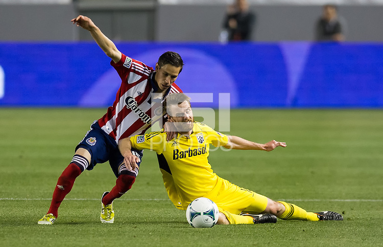 CARSON, CA - March 2, 2013: Chivas midfielder Eric Avila (15) and Columbus midfielder Eddie Gaven (12) during the Chivas USA vs Columbus Crew match at the Home Depot Center in Carson, California. Final score, Chivas USA 0, Columbus Crew 3.