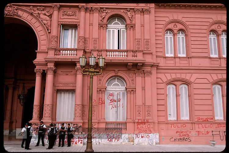 Protesters angry about the government policy of freezing bank accounts and devaluating the peso left graffiti on the wall of the Casa Rosada, Argentina's presidential palace where leaders of the nation address the masses from it's balcony. Casa Rosada was built in 1894 and is known for it's pink color. Beef, fat, blood and lime were mixed to get this result.
