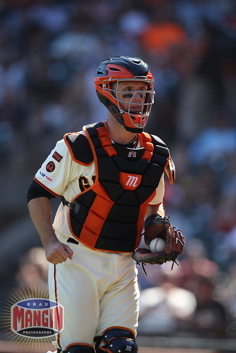 SAN FRANCISCO, CA - SEPTEMBER 12:  Buster Posey #28 of the San Francisco Giants runs off the field during the game against the Pittsburgh Pirates at Oracle Park on Thursday, September 12, 2019 in San Francisco, California. (Photo by Brad Mangin)