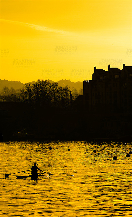 Solitary rower training in Bristol Docks in February