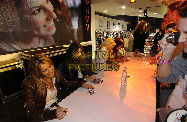 "CHERYL TWEEDY, NICOLA ROBERTS & SARAH HARDING (GIRLS ALOUD).Instore record signing for latest single ""Wake Me Up"" at HMV Oxford Street, London, February 22nd 2005..half length .Ref: HT.www.capitalpictures.com.sales@capitalpictures.com.©Capital Pictures."