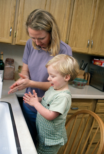 Berkeley CA Boy, two and a half years old, learning hygiene by copying mom's hand washing  MR