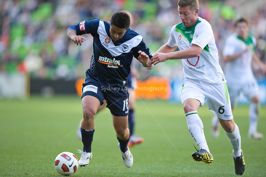 MELBOURNE, AUSTRALIA - AUGUST 22, 2010: Carlos Hernandez from the Victory holds off Ufuk Talay from the Fury in Round 3 of the 2010 A-League between the Melbourne Victory and North Queensland Fury at AAMI Park on August 22, 2010 in Melbourne, Australia. (Photo by Sydney Low / Asterisk Images)