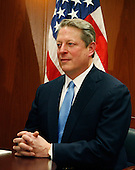 Chicago, IL - December 9, 2008 -- Former Vice President Al Gore sits after a private meeting with United States President-elect Barack Obama and Vice President-elect Joe Biden at Obama's transition office on December 9, 2008 in Chicago, Illinois. An Obama spokesman said the three men discussed energy and climate change and how policies in those areas could help the economy..Credit: Brian Kersey - Pool via CNP