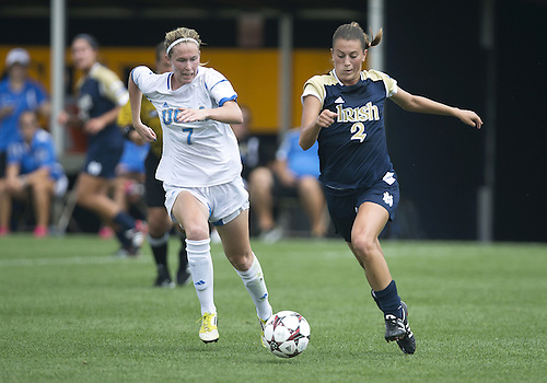 September 01, 2013:  Notre Dame midfielder Mandy Laddish (2) advances the ball as UCLA midfielder Jenna Richmond (7) defends during NCAA Soccer match between the Notre Dame Fighting Irish and the UCLA Bruins at Alumni Stadium in South Bend, Indiana.  UCLA defeated Notre Dame 1-0.