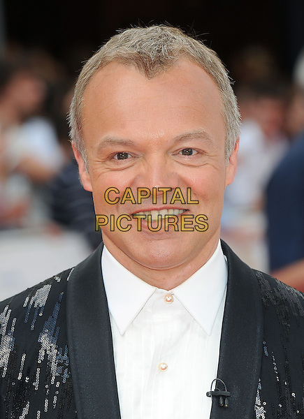 GRAHAM NORTON .at the Philips British Academy Television Awards (BAFTA) at the London Palladium, London, England,.June 6th, 2010..BAFTAs TV arrivals portrait headshot sequined sequin jacket smiling black suit white shirt .CAP/BEL.©Tom Belcher/Capital Pictures.