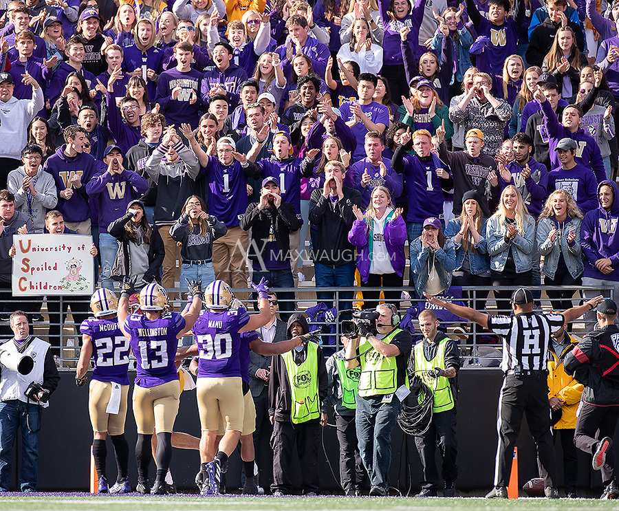 The Washington student section celebrates after the Husky defense held off USC at the goal line.