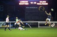 Luke Daniels of Ealing Trailfinders kicks the conversion as Tristan Roberts holds the ball during the Greene King IPA Championship match between London Scottish Football Club and Ealing Trailfinders at Richmond Athletic Ground, Richmond, United Kingdom on 26 December 2015. Photo by Alan  Stanford / PRiME Media Images
