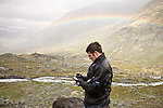 Robert Way conducts Schmidt Hammer tests on the rocks of a glacial moraine to determine density.