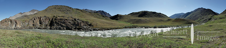 The Hulahula River canyon features multiple rapids as is flows north on a summer day from Alaska's Brooks Range mountains to the Coastal Plain in the Arctic National Wildlife Refuge. STITCHED PANORAMA