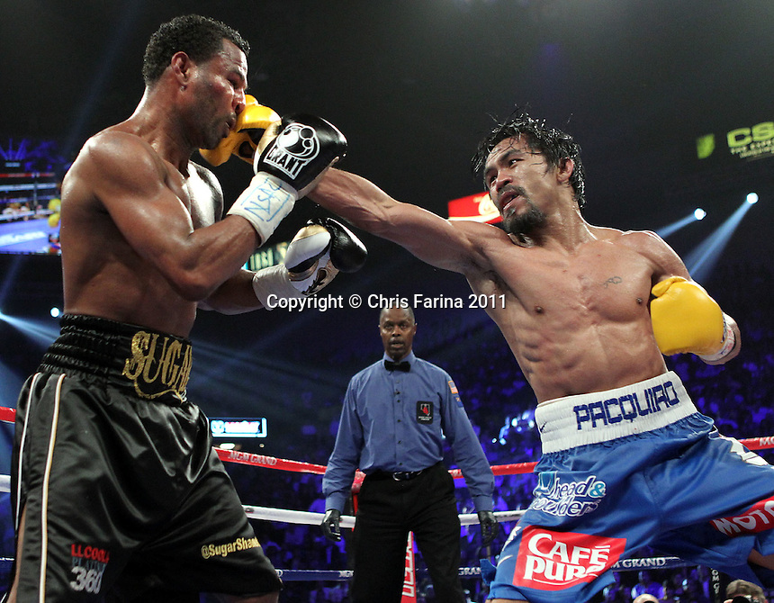 "May 7, 2011,Las Vegas,Nevada  --- Superstar Manny Pacquiao(R) wins a 12 round unanimous decision against ""Sugar"" Shane Mosley at the MGM Grand Garden Arena in Las Vegas.  --- Photo Credit : Chris Farina - Top Rank  (no other credit allowed)  copyright 2011 ."