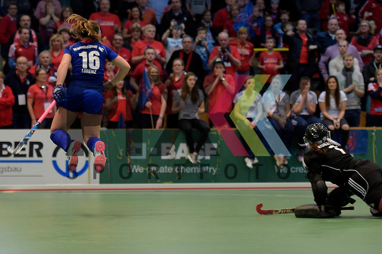 GER - Luebeck, Germany, February 07: During the 1. Bundesliga Damen indoor hockey final match at the Final 4 between Mannheimer HC (blue) and Duesseldorfer HC (white) on February 7, 2016 at Hansehalle Luebeck in Luebeck, Germany. Final score 6-4 after shootout.  Nike Lorenz #16 of Mannheimer HC scores the final goal during shoot-out; Nathalie Kubalski (TW) #1 of Duesseldorfer HC