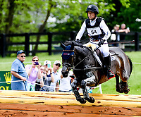 LEXINGTON, KENTUCKY - APRIL 29: Fischerrocana FST #54, with rider Michael Jung (GER), clear an obstacle as they take the lead during the Cross Country Test at the Rolex Kentucky 3-Day Event at the Kentucky Horse Park on April 29, 2017 in Lexington, Kentucky. (Photo by Scott Serio/Eclipse Sportswire/Getty Images)