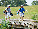 MUSCLE SHOALS, AL - MAY 25: Lynn's Carlos Bustos, left, and West Florida's Chandler Blanchet chat as the cross the bridge to the No. 9 tee box during the Division II Men's Team Match Play Golf Championship held at the Robert Trent Jones Golf Trail at the Shoals, Fighting Joe Course on May 25, 2018 in Muscle Shoals, Alabama. Lynn defeated West Florida 3-2 to win the national title. (Photo by Cliff Williams/NCAA Photos via Getty Images)
