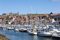 The ruins of the Benedictine Abbey still dominate the town of Whitby, North Yorkshire, England, from where Captain James Cook set our on his first voyage of discovery but, as the harbour gives way inland to the River Esk, the fishing boats are replaced by yachts and pleasure boats.