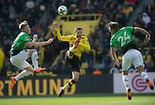 18th March 2018, Dortmund, Germany;  Football Bundesliga, Borussia Dortmund versus Hannover 96 at the Signal Iduna Park. Dortmund's Gonzalo Castro (c) challenges Felix Klaus (l) and Niclas Fg of Hanover  for the ball.