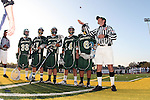 Manhattan Beach, CA 05/12/09 - Head Referee Tim Rossi conducts the coin toss as Mira Costa Captains Joseph Marinelli (MC#6), Kevin Looney (MC#14), Christian Haase (MC#12), Austin Dorr (MC#21) and Sean Donohue (MC#33) look on.