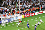 04 July 2006: German fans watch as the shot from Fabio Grosso (ITA) (not pictured) flies past goalkeeper Jens Lehmann (GER) (in orange) and inside the far post, giving Italy a 1-0 lead in the 119th minute. Italy defeated Germany 2-0 in overtime at Signal Iduna Park, better known as Westfalenstadion, in Dortmund, Germany in match 61, the first semifinal game, in the 2006 FIFA World Cup.