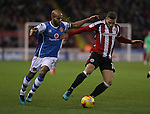 Billy Sharp of Sheffield United stopping Adam Chambers of Walsall from getting to the ball during the English Football League One match at Bramall Lane, Sheffield. Picture date: November 29th, 2016. Pic Jamie Tyerman/Sportimage