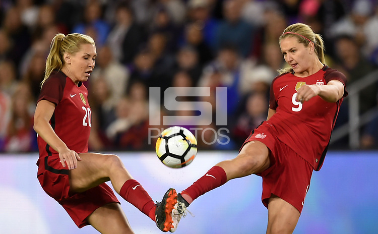 Orlando City, FL - Wednesday March 07, 2018: Allie Long, Lindsey Horan during a 2018 SheBelieves Cup match between the women's national teams of the United States (USA) and England (ENG) at Orlando City Stadium.