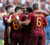 Calcio, Serie A: Roma vs Sampdoria. Roma, stadio Olimpico, 11 settembre 2016.<br /> Roma&rsquo;s Mohamed Salah, second from right, celebrates with teammates after scoring during the Italian Serie A football match between Roma and Sampdoria at Rome's Olympic stadium, 11 September 2016. Roma won 3-2.<br /> UPDATE IMAGES PRESS/Isabella Bonotto