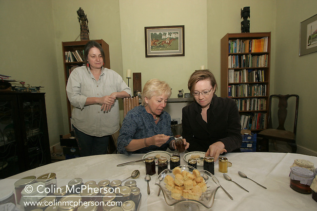 Annette Gibbons (centre) and writer Fiona Sims tasting preserves made by Jane Maggs at Wild and Fruitful at her home in Cumbria. This location was part of a slow food safari run by Annette Gibbons of Cumbria On A Plate a tourism business which guides visitors around various Cumbrian food producers and rounds off with a meal cooked in her house. Annette is the Cumbrian Woman of the Year and has a recently-published book on Cumbrian food.