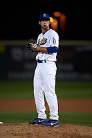 Rancho Cucamonga Quakes relief pitcher Zach Pop (45) prepares to deliver a pitch during a California League game against the Lake Elsinore Storm at LoanMart Field on May 19, 2018 in Rancho Cucamonga, California. Lake Elsinore defeated Rancho Cucamonga 10-7. (Zachary Lucy/Four Seam Images)