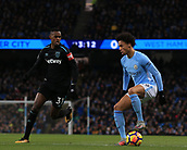 3rd December 2017, Etihad Stadium, Manchester, England; EPL Premier League football, Manchester City versus West Ham United; Leroy Sane of Manchester City holds the ball as Edimilson Fernandes of West Ham pressures