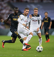 Vincent Janssen of Tottenham Hotspur plays a pass under pressure from Tiemoue Bakayoko of Monaco during the UEFA Champions League Group stage match between Tottenham Hotspur and Monaco at White Hart Lane, London, England on 14 September 2016. Photo by Andy Rowland.