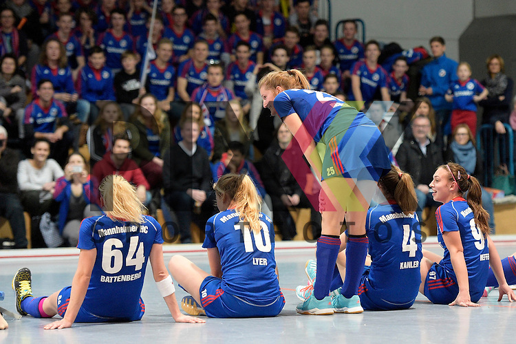 GER - Mannheim, Germany, January 30: During the 1. Bundesliga Damen indoor hockey quarter final match between Mannheimer HC (blue) and TuS Lichterfelde (black) on January 30, 2016 at Irma-Roechling-Halle in Mannheim, Germany.   Mannheimer HC celebrates after winning 2-1; Laura Bassemir #25 of Mannheimer HC standing<br /> <br /> Foto &copy; PIX-Sportfotos *** Foto ist honorarpflichtig! *** Auf Anfrage in hoeherer Qualitaet/Aufloesung. Belegexemplar erbeten. Veroeffentlichung ausschliesslich fuer journalistisch-publizistische Zwecke. For editorial use only.