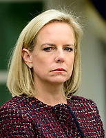 United States Secretary of Homeland Security (DHS) Kirstjen Nielsen listens as US President Donald J. Trump makes a statement following his meeting with Democratic leaders in the Situation Room of the White House in Washington, DC in an effort to break the political impasse on border security and reopen the federal government on Friday, January 4, 2018.  The President also took questions from reporters. Photo Credit: Ron Sachs/CNP/AdMedia