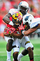D.J. Moore of the Terrapins is brought down by the Bison defense. Maryland routed Howard 52-13 during home season opener at Capital One Field in College Park, MD on Saturday, September 3, 2016.  Alan P. Santos/DC Sports Box