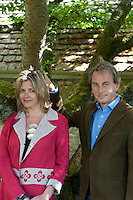 Philip Mould and his wife Catherine in the garden of their Grade II listed Jacobean country house in Oxfordshire