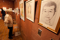 Self portrait at an exhibition by political Prisoner, Fumiaki Hoshino in Nakano, Tokyo, Japan. Sunday October 2nd 2016. Fumiaki Hoshino was a student activist during the turbulent anti-Vietnam war demos of the 1970s. He was arrested in 1975 for the murder of a policeman in a riot in Shibuya in 1971 and sentenced to life imprisonment despite there being important issues with the case that cast doubt on Hoshino's guilt. He remains incarcerated to this day. His wife, Akiko Hoshino campaigns for his release. Hoshino san was allowed to begin painting in the prison art class a few years ago and the Free Hoshino campaign began by his wife puts on regular exhibitions of his art to raise awareness of this long-serving political prisoner who is virtually unknown domestically or internationally..