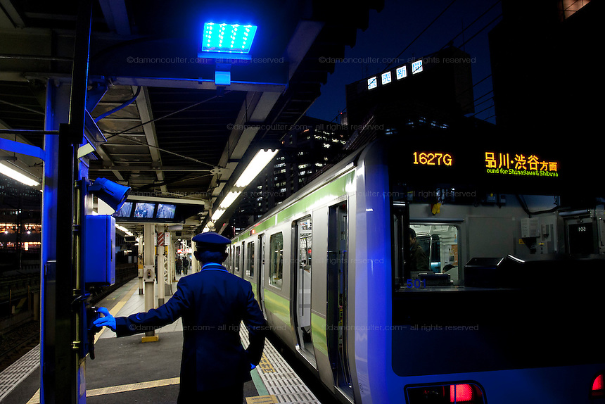 Blue lights installed at all 29 JR Yamanote Line stations for a cost of 15 million Yen (165,000 USD) in an effort to decrease suicides by people jumping under trains. Over 2,000 people jumped under trains in 2008, accounting for 6% of all suicides in the country. The blue LED lights are meant to calm and soothe potential jumpers, though there is little scientific evidence for this. Japan has one of the highest suicide rates in the world which the recent economic crisis has exacerbated. Shimbashi Station, Tokyo, Japan December 4th 2009