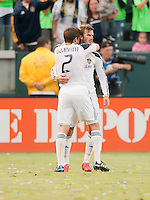 CARSON, CA – OCTOBER 24: LA Galaxy players Todd Dunivant and David Beckham celebrate Beckham's goal during a soccer match at the Home Depot Center, October 24, 2010 in Carson, California. Final score LA Galaxy 2, Dallas FC 1.