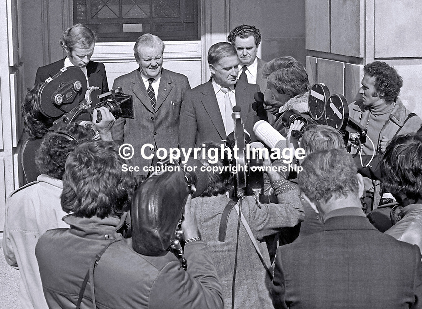 Ulster Vanguard leader William Craig speaks to media about power sharing row as he emerges from Parliament Building, Stormont, Belfast, N Ireland, UK. Flanking Craig are Reg Empey &amp; Cecil Harvey. UTV reporter Brian Black is extreme left. Man with wavy hair not known. If anyone can positively identify please contact me. 197509150641j.<br />