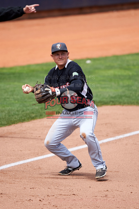 New Britain Rock Cats third baseman Pat Valaika (12) throws to first after fielding a ground ball during a game against the Akron RubberDucks on May 21, 2015 at Canal Park in Akron, Ohio.  Akron defeated New Britain 4-2.  (Mike Janes/Four Seam Images)