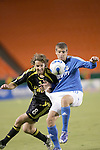 SEP 15  2007:  Duncan Oughton (8)  of the Crew grabs the shorts of Carlos Marinelli (10) of the Wizards as Marinelli wins the ball.  The MLS Kansas City Wizards defeated the visiting Columbus Crew 3-2 at Arrowhead Stadium in Kansas City, Missouri, in a regular season league soccer match.